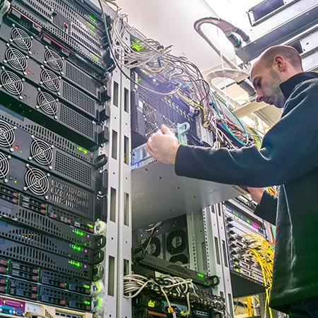 technician interfacing with server technology